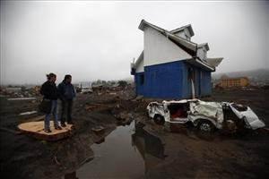Survivors survey the damage in Chile.