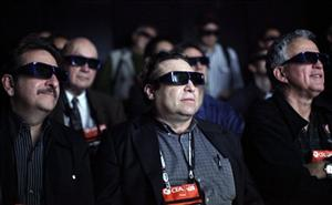 In this Jan. 7, 2009 file photo, members of the media wear 3D glasses as they watch movie clips at the Panasonic 3D full HD plasma theater at the International Consumer Electronics Show in Las Vegas.