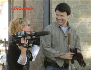 In this Dec. 27, 2006 photo provided by the National Enquirer, John Edwards is shown with videographer Rielle Hunter in the 9th Ward of New Orleans, La.