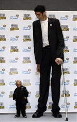 He Pingping of China and Sultan Kosen of Turkey during a Guinness World Records event in Istanbul, Jan. 14, 2010. At 8-foot-1, Kosen is the world's tallest man; 29-inch He was the world's shortest.