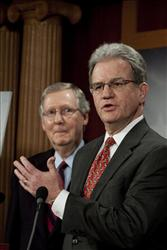 Sen. Tom Coburn, R-Okla., right, speaks at a news conference about the pending health care bill as Senate Minority Leader Mitch McConnell, R-Ky, listens on.