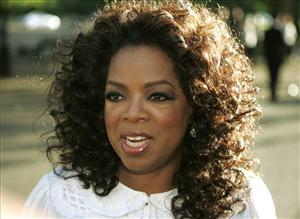 In this June 25, 2008 file photo, Oprah Winfrey arrives for the dinner birthday party of former president of South Africa Nelson Mandela in central London's Hyde Park.