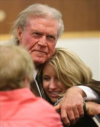 Country singer Billy Joe Shaver, left  hugs Kimberly Kelly, right ,after closing arguments Friday, April 9, 2010 in Waco Texas. Shaver, 70, is charged with shooting Billy Bryant Coker outside Papa Joe's Texas Saloon in Lorena, Texas on April 1, 2007.