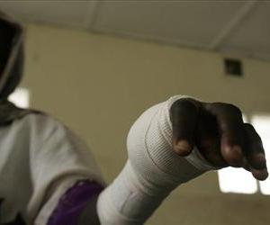 An unidentified woman who is a victim of gang-rape and who had cut off her own thumb as a result of the severe mental trauma is seen at a hospital in Goma, Congo, Monday, Nov. 26, 2007.