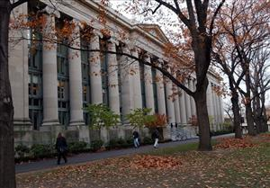 Students walk through the Harvard Law School area on the campus of Harvard University in Cambridge, Mass., in this Nov. 19, 2002 file photo.
