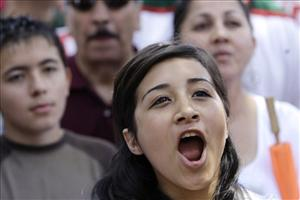 Beatriz Manzano, of Mesa, Ariz., shouts as she joins thousands of protesters attending a rally at the Arizona Capitol.