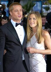 In this May 13, 2004 file photo, Brad Pitt, left, arrives with Jennifer Aniston at the screening of his film Troy at the 57th International Film Festival in Cannes, southern France.