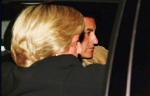 In this image by photographer Jacques Langevin, and made available from evidence presented at the inquest into the death of Diana, Princess of Wales, and Dodi Al Fayed in London, Thursday, Oct. 11, 2007, The Princess of Wales and Dodi Fayed leave the Ritz Hotel in Paris, on Aug. 30,...