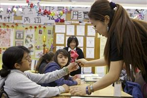 In this photo taken on April 20, 2010, Cedarlane Middle School teacher, Angela Wang, right, teaches Origami as part of a Chinese Language and Culture class in the Hacienda Heights area of Los Angeles.