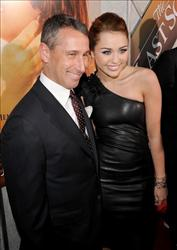 Adam Shankman and Miley Cyrus arrive at the premiere of Touchstone Picture's 'The Last Song' held at ArcLight Hollywood on March 25, 2010 in Los Angeles, California.