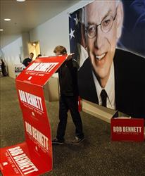 Scott Peterson, a volunteer for the campaign of Senator Bob Bennett, R-Utah, removes campaign signs after Bennett was defeated on May 8.