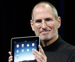 In this Jan. 27, 2010 photo shows Apple CEO Steve Jobs holding up the new iPad during a product announcement in San Francisco.