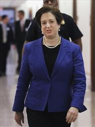 Supreme Court nominee Elena Kagan walks towards the office of Sen. Blanche Lincoln, D-Ark., on Capitol Hill in Washington, Thursday, May 20, 2010.