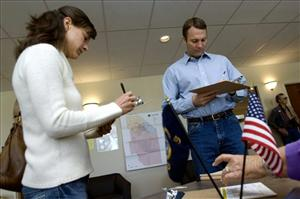 Idaho House candidate Vaughn Ward and his wife Kirsten Ward complete their voter registration before casting their ballots in the Idaho primary on Tuesday, May 25, 2010 in Eagle, Idaho.