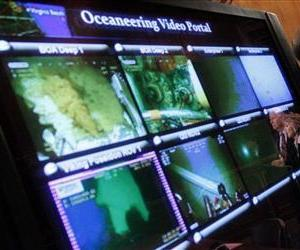 A live video feed of the gulf oil spill is seen during a news conference held by Senators Barbara Boxer and Benjamin Cardin on Capitol Hill, May 26, 2010.