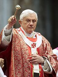 Pope Benedict XVI sprinkles holy water as he celebrates a Pentecost Mass inside St. Peter's Basilica, at the Vatican, Sunday, May 23, 2010.