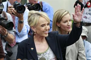 Arizona Gov. Jan Brewer waves as she speaks to reporters outside the White House in Washington, Thursday, June 3, 2010, after a private meeting with President Barack Obama.
