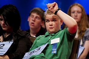 Thomas Bates, of Driggs, Idaho, cleans his glasses at the 2010 Scripps National Spelling Bee in Washington yesterday.