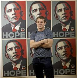 In this Jan. 12, 2009 file photo, Los Angeles street artist Shepard Fairey poses for a picture in front of  Barack Obama HOPE posters in the Echo Park area of Los Angeles.