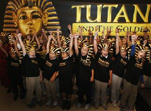 In this image released by the Dallas Museum of Art, children from the George Bannerman Dealey Montessori School  cheer the coming of Tutankhamun and The Golden Age of Pharaohs exhibition during a news conference, Monday, Oct. 22, 2007, at the Dallas Museum of Art in Dallas. The exhibition, scheduled to...