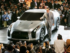 Nissan CEO Carlos Ghosn gestures next to the company's new GT-R at the press preview for the 39th Tokyo Motor Show at Makuhari Messe, near Tokyo, in this Oct. 19, 2005 file photo. (AP Photo/Itsuo Inouye, FILE)