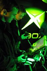 Gamers playing Xbox 360