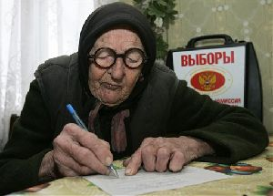 Alexandra Zhaldybina, 101, signs in papers before voting in a village of Markovo, 80 kilometers (50 miles) west of Smolensk, western Russia, Sunday, Dec. 2, 2007. Russians voted Sunday in a parliamentary election where the only question is whether President Vladimir Putin's party will win merely a strong majority of...