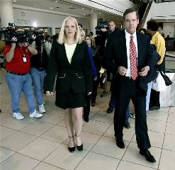 Former middle school teacher Debra Lafave, center, leaves the Hillsborough County Courthouse in this Nov. 22, 2005 file photo with her attorney John Fitzgibbons, right, after pleading guilty to having sex with a 14-year-old student. Lafave 25, avoided prison time with a plea deal. (AP Photo/Chris O'Meara/FILE)