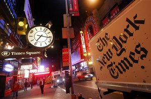 A New York Times delivery truck stops in New York's Times Square in this Oct. 19, 2005 file photo. Newspaper publisher New York Times Co. said Thursday, April 19, 2007 that its first-quarter profit fell 26 percent, hurt by weakness in print advertising and various charges.  (AP Photo/Mark Lennihan, file)