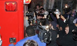Photographers try to get a shot through the back window of a Los Angeles City Fire Department ambulance carrying entertainer Britney Spears, as it leaves her residence, Thursday, Jan. 3, 2008, in Los Angeles. Britney's increasingly erratic behavior has led some to fear she is risking an early death. (AP...