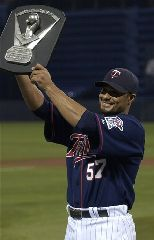 Minnesota Twins pitcher Johan Santana shows the Cy Young Award, for being the best pitcher in the American League in 2006, that he received prior to the Twins baseball game against the Tampa Bay Devil Rays, in this April 14, 2007 file photo, in Minneapolis. The Minnesota Twins reached a...