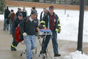 In this photo provided by the student-run Northern Star newspaper, rescue workers carry an unidentified victim from the scene of a shooting  at a lecture hall at Northern Illinois University in DeKalb, Ill., Thursday, Feb. 14, 2008. A man dressed in black opened fire with a shotgun from a stage...