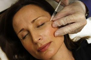 Colleen Delsack, 47, of Alexandria, Va., has Botox injected  by Dr. Shannon Ginnan,  at Reveal in Arlington, Va. on Friday, June 5, 2009.