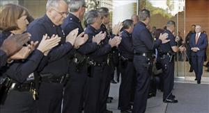 Rank-and-file officers and staff applaud outgoing Los Angeles Police Chief William Bratton at an End Of Watch ceremony at police headquarters in downtown Los Angeles Wednesday, Oct. 28, 2009.