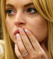 Lindsay Lohan listens to court proceedings with a message to the world on her middle finger.