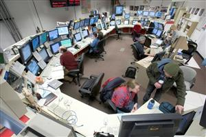 Fermilab scientists work in the control room of the collider searching for the Higgs boson.
