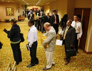 In this photo taken June 28, 2010, job seekers wait in line to register and attend a National Career Fair in San Francisco.