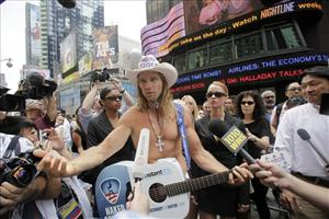FILE - In this July 22, 2009 file photo, Robert Burck, also known as The Naked Cowboy, speaks to reporters during a news conference in New York's Times Square. One of Times Square's best-known entertainers is heading to court to protect his trademark. The Naked Cowboy is suing the Naked...