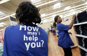 Wal-Mart sales associates arrange clothing at a new Wal-Mart store in Evergreen Park, Illinois.