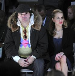 In this Feb. 5, 2008 file photo, Simon Monjack, left, and actress Brittany Murphy, attend the Monique Lhuillier 2008 Fall Collection during Fashion Week, in New York.