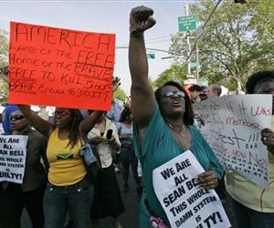 Protestors of the Sean Bell verdict gather on 125th street in New York in this Wednesday, May 7, 2008 file photo.