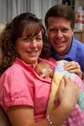 In this Jan. 18, 2010 publicity image released by TLC, Jim Bob and Michelle Duggar hold their daughter Josie Brooklyn Duggar, born Dec. 11, at Arkansas Children's Hospital in Little Rock, Ark.