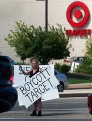 Laura Hedlund and Sue Skog protest in front of a Target store after Target donated money to a PAC that is supporting the Republican candidate in the governor's race in Bloomington, Minn.