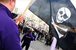A Pirate Bay supporter waves a Jolly Roger during a demonstration in Stockholm.
