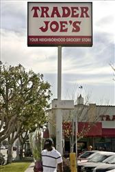 In this Feb. 11, 2008 file photo, a customer departs Trader Joe's in Los Angeles.