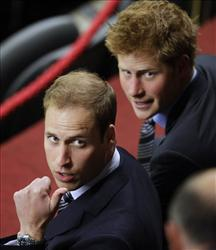 Prince William and Prince Harry await the start of a World Cup match in Cape Town earlier this summer.