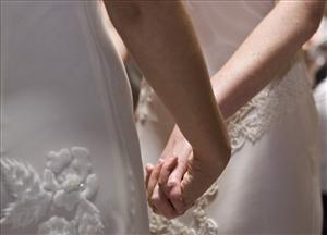 In this file photo taken June 17, 2008, a same-sex couple hold hands during their wedding ceremony at City Hall in San Francisco.