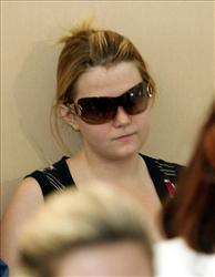 Natascha Kampusch, who was held captive in a windowless cell for over 8 years, appears during a news conference in Vienna in 2007.