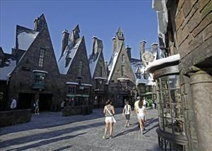 Visitors stroll the streets of Hogsmeade in The Wizarding World of Harry Potter at Universal Orlando theme park in Orlando, Fla.