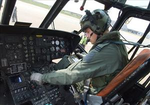This image of Sept. 3, 2010 released by the British Ministry of Defense on Friday Sept. 17, 2010 shows Prince William at the controls of his Sea King helicopter in Bangor, Wales.